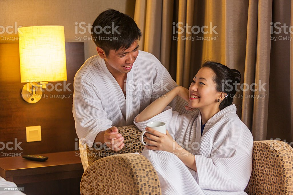 Robe Wearing Young Asian Couple With A Hot Drink Stock Photo   More ... 42dd940da