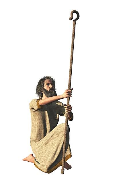 Robed bearded hermit with shepherd crook stock photo