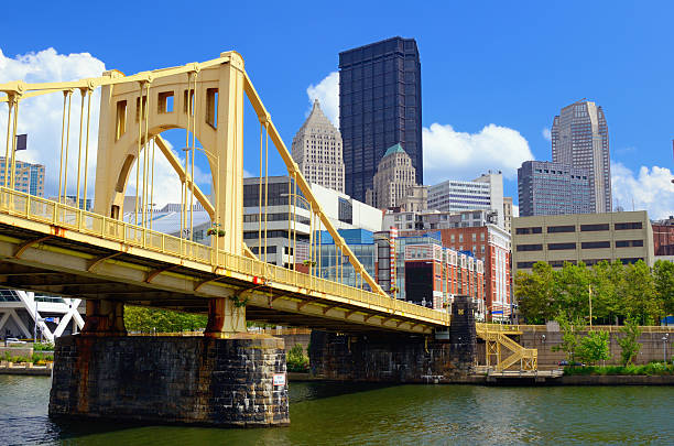 Roberto Clemente bridge over Allegheny River in Pittsburgh Skyscrapers in downtown at the waterfront of Pittsburgh, Pennsylvania, USA. monongahela river stock pictures, royalty-free photos & images