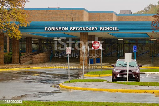 Fairfax, Virginia / USA - October 30, 2020: The main entrance to the James W. Robinson Jr. Secondary School, one of the many schools in the Fairfax County Public Schools system.