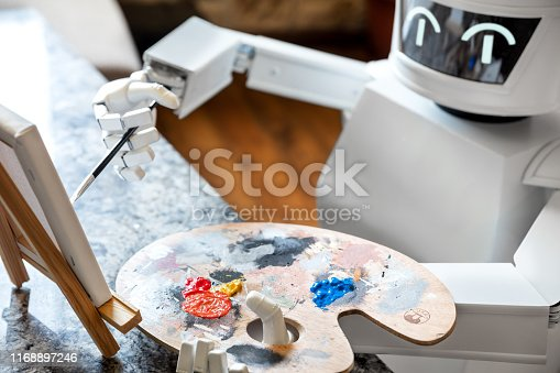910163152 istock photo robot ai artificial intelligence is learning creativity by using a painter palette, doing a artwork, concept autonomous robot is going to be an artist 1168897246