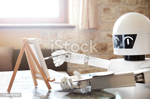 910163152 istock photo robot ai artificial intelligence is learning creativity by using a painter palette, doing a artwork, concept autonomous robot is going to be an artist 1168897807