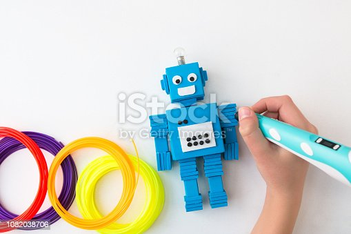 1082038948 istock photo Robot and 3D pen. STEM and STEAM. 1082038706