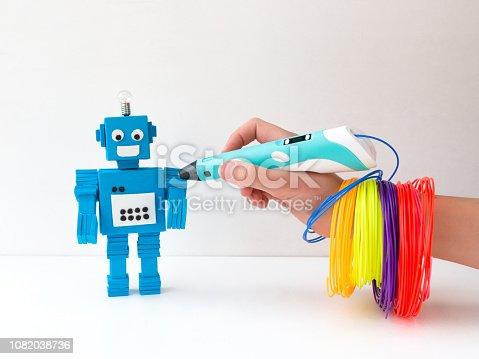 1082038948 istock photo Robot and 3D pen. STEM and STEAM. 1082038736