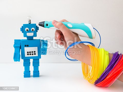 1082038948 istock photo Robot and 3D pen. STEM and STEAM. 1082038822