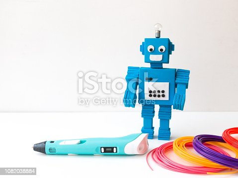 1082038948 istock photo Robot and 3D pen. STEM and STEAM. 1082038884