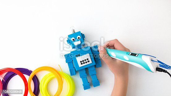 istock Robot and 3D pen. STEM and STEAM. 1082038948