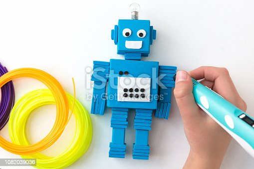 1082038948 istock photo Robot and 3D pen. STEM and STEAM. 1082039036
