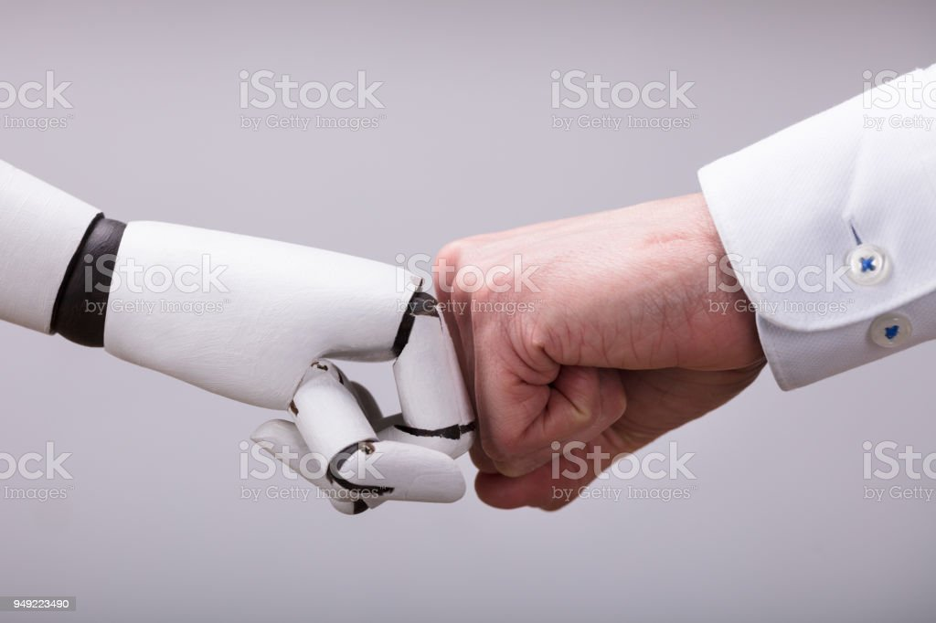 Robot And Human Hand Making Fist Bump stock photo