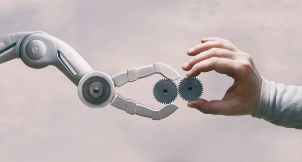 Robot And Human Hand with Gears Robot and human working together. Artificial Intelligence stock pictures, royalty-free photos & images