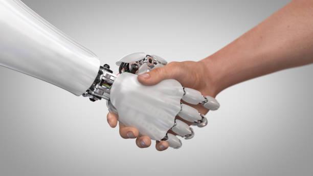 robot y el hombre agitando las manos - robot fotografías e imágenes de stock