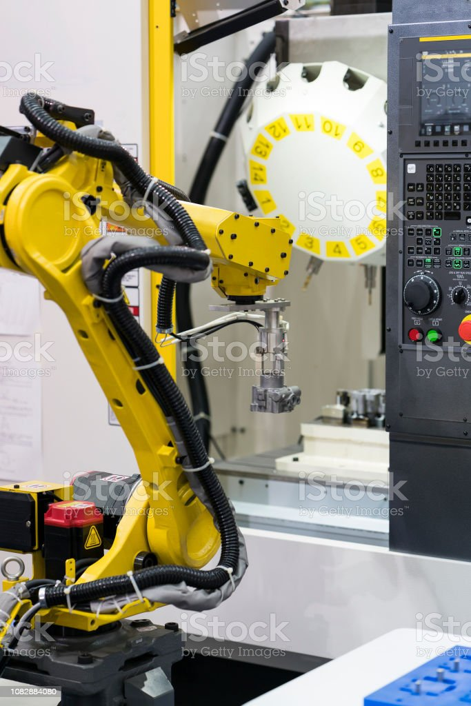 Robot arm auto load and unload CNC turning part stock photo
