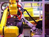 Robot arm in machine tool metalworking process for industry manufacture