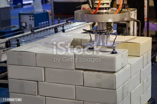 istock Robot arm loading in factory 1149697280