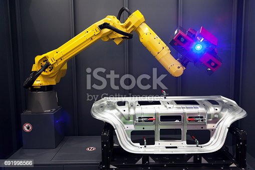 istock Robot arm with 3D scanner. Automated scanning. 691998566