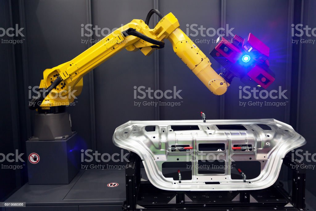 Robot arm with 3D scanner. Automated scanning. stock photo