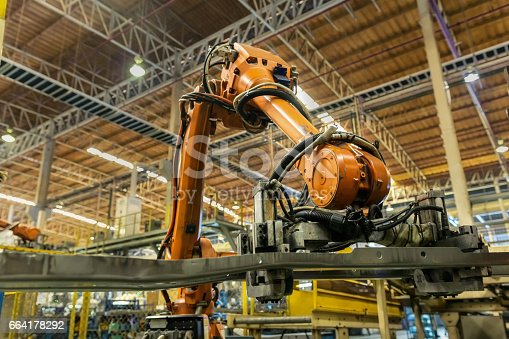 846859964 istock photo Robot arms handle tool keep automotive part to spot machine 664178292