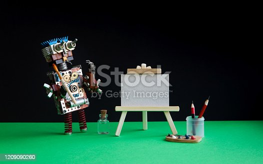 910163152 istock photo Robot artist begins to create a drawing with a brush. White paper template, wooden easel, palette and painter accessories. Black green background. 1209090260