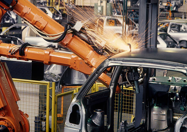 Robot assembles car in factory stock photo