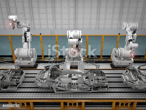 849023956 istock photo robot assembly line in car factory 845040742