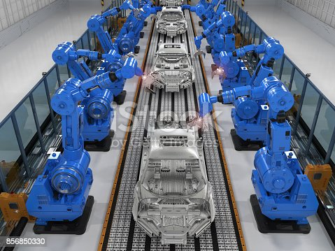 849023956 istock photo robot assembly line in car factory 856850330