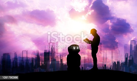 1091790372 istock photo Robot assistant technology , industry 4.0 , artificial intelligence trend concept. Silhouette of engineer man control to automation robo advisor. Vivid twilight sunset sky with building background. 1091790366