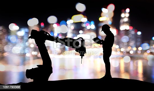 istock Robot assistant technology , industry 4.0 , artificial intelligence trend concept. Silhouette of engineer man control to automation robo advisor arm. Bokeh flare light effect with building background. 1091790368