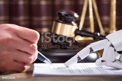 istock Robot Assisting Person In Filling Form 949223230