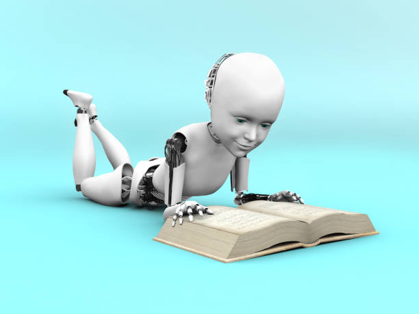 A robot child lying on the floor and reading a book. stock photo