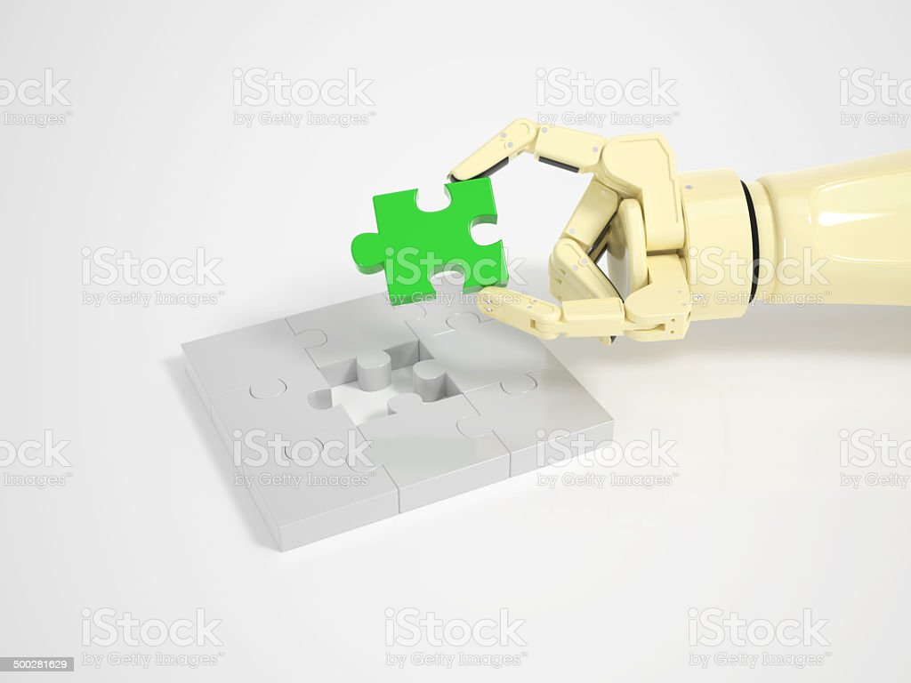 Robot completes jigsaw puzzle game royalty-free stock photo