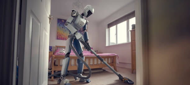 Robot Doing Household Cleaning With Vacuum Cleaner stock photo