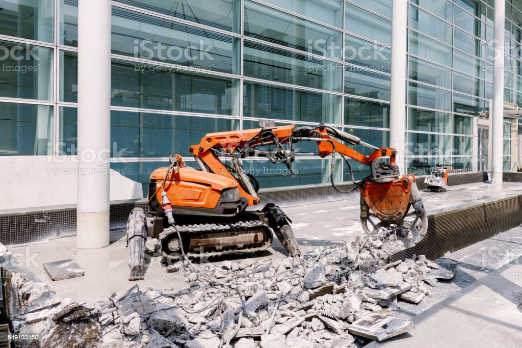 Robot Equipment is destroying the floor In construction zone. stock photo
