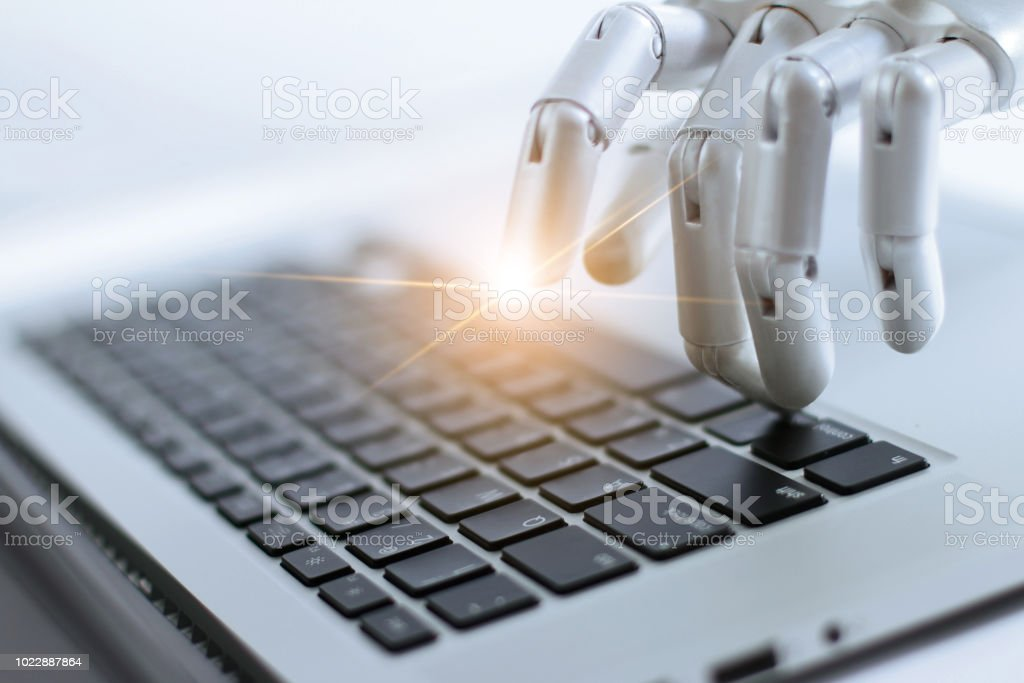 Robot finger point and working to laptop keyboard button, AI, Artificial Intelligence, Robotic hand on digital gray background. Futuristic technology concept. stock photo