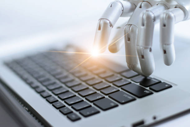 robot finger point and working to laptop keyboard button, ai, artificial intelligence, robotic hand on digital gray background. futuristic technology concept. - automated stock photos and pictures
