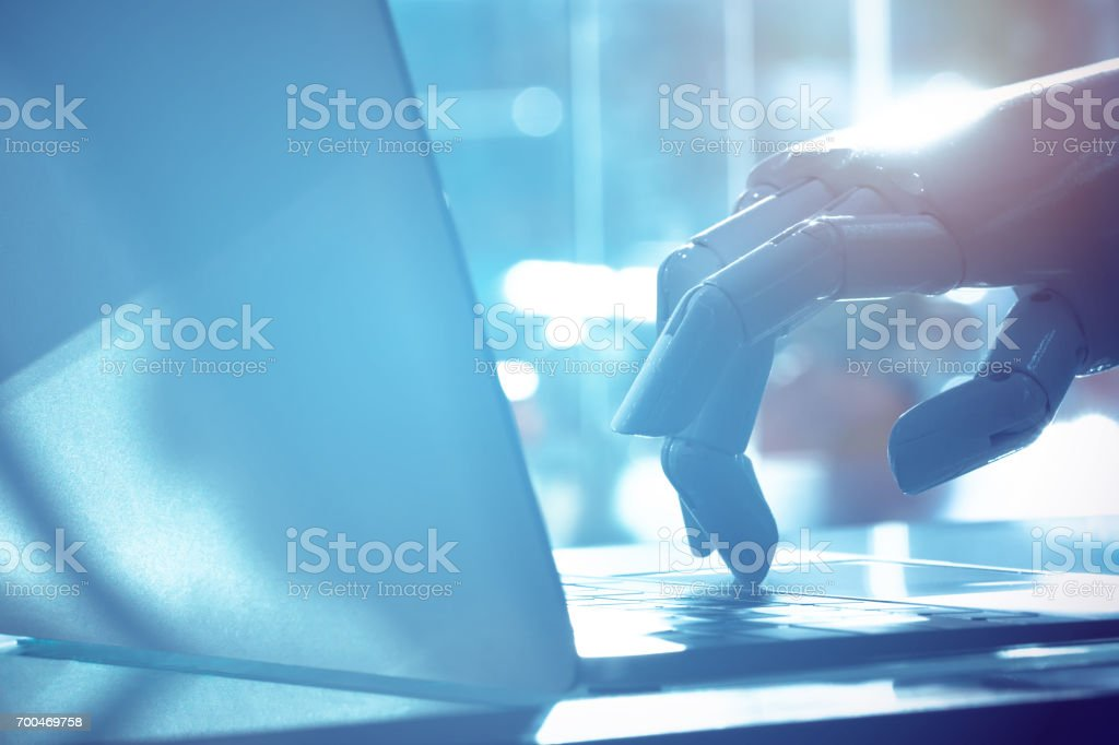 Robot finger point to laptop button with blue tone image. Chat bot , artificial intelligence , robo advisor , robotic concept. стоковое фото