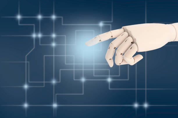 Robot hand AI pointing finger at dark background stock photo
