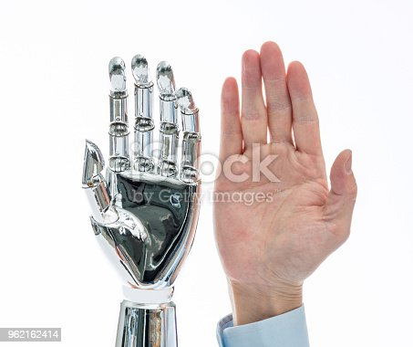 istock Robot hand and man hand on white background 962162414