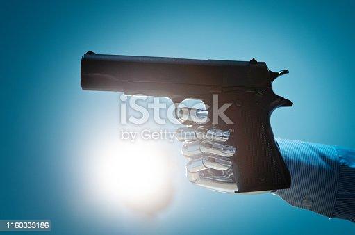 Robot hand holding a gun.