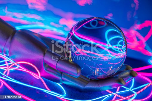 Robot hand holding glass sphere with glowing fiber neon communication wires