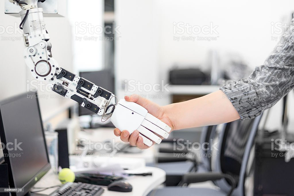 robot hand holds the objects drawn to a man's hand royalty-free stock photo