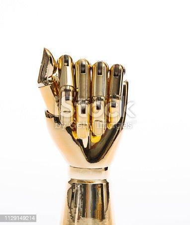 istock Robot hand on white background 1129149214