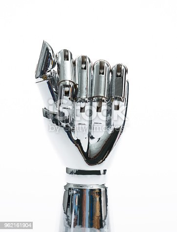 istock Robot hand on white background 962161904