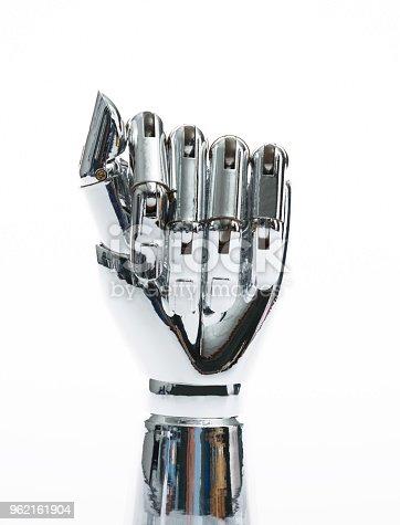 istock Robot hand on white background 962161904