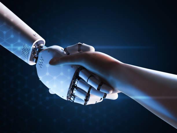 robot hand shake with human stock photo