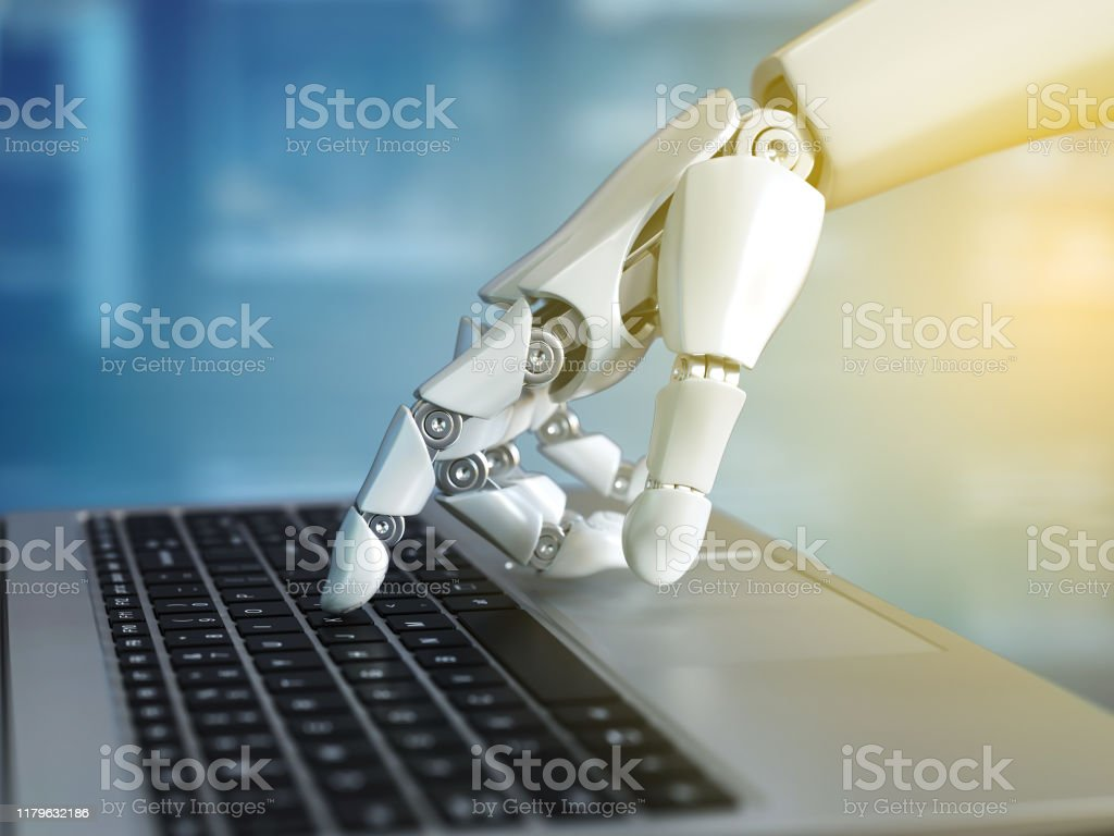 Robot hand typing on the laptop keyboard - Royalty-free Accessibility Stock Photo