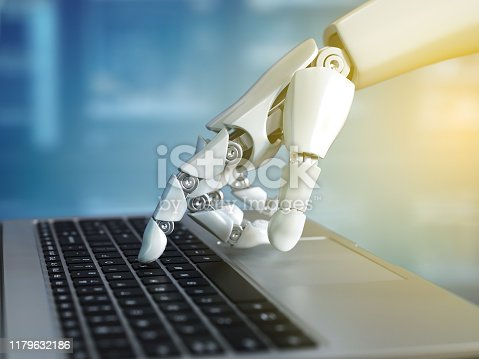 istock Robot hand typing on the laptop keyboard 1179632186