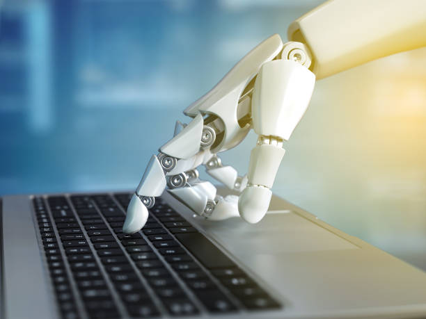 robot hand typing on the laptop keyboard - cybernetic stock pictures, royalty-free photos & images