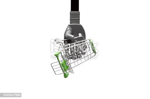 istock Robot hand with shopping cart. 1043447560