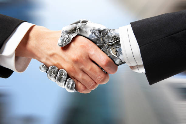 robot handshake - cybernetic stock pictures, royalty-free photos & images