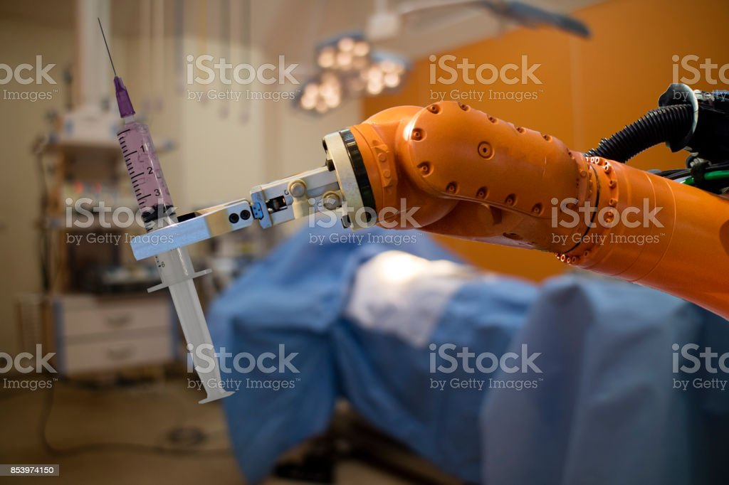 robot in medical concept, robot (artificial intelligence)hold the medical syringe in the operating room  for prepare to surgery the patient for faster recovery time, less cosmetic damage and low costs stock photo